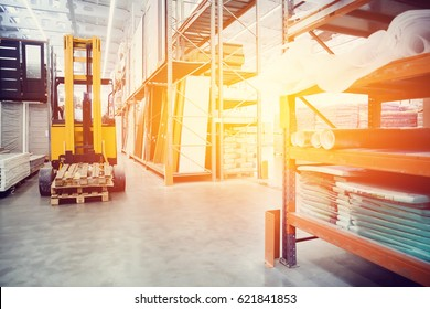 forklift loader pallet Building materials warehouse, logistics concept, construction of houses, loader. high contrast and monochrome color tone.