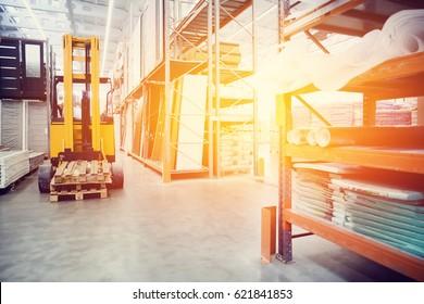 forklift loader pallet Building materials warehouse, logistics concept, construction of houses, loader. high contrast and monochrome color tone.