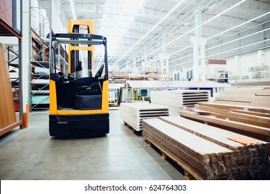 forklift loader pallet Building materials warehouse, logistics concept, construction of houses, loader.