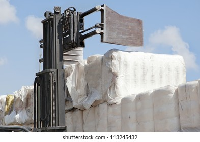 Forklift loading the bales of coton in a truck (TIR)  - Cotton bales, ready for delivery to cotton buyers.