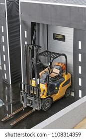 Forklift at Loading Dock Door Distribution Warehouse