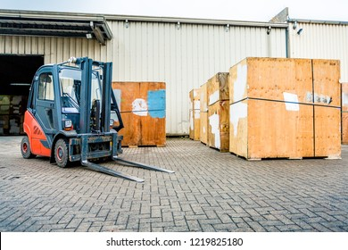 forklift outside in front of a warehouse