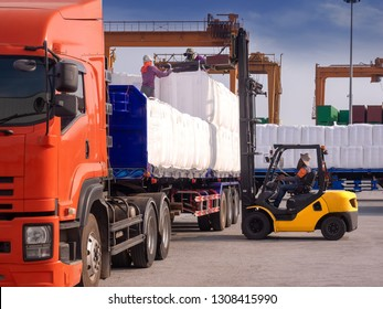 Forklift pick up the tapioca in jumbo bags from truck to storage in warehouse for export.