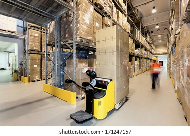 Forklift with products in a warehouse