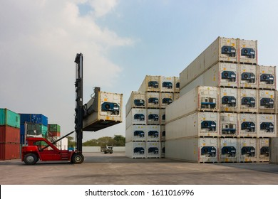 Forklift reach stacker is lifting the reefer container in the container depot as for business and shipping logistics background.