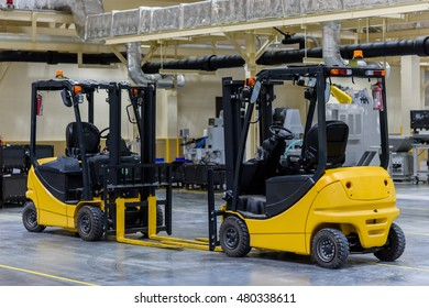 Forklift stand by for lifting up parts in factory