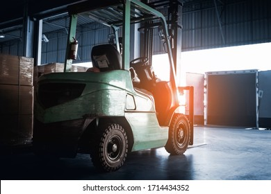 forklift tractor loader at the warehouse. truck parked loading at dock warehouse. road freight industry delivery, shipping warehouse logistics and transport.