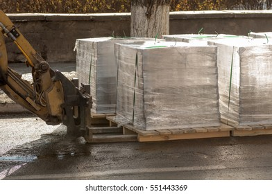 forklift transports the pallet with the load