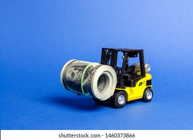 Forklift truck carries a bundle of dollars. Export of capital, offshore economic zones. Attracting direct investment in business and production, improving economic performance. capitalism.