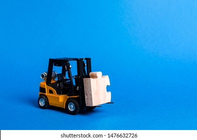 Forklift truck carries part of the puzzle. Business processes and globalization concept. Take a Niche Market. Take part in a large project or economic process. investment. Startup, crowdfunding.