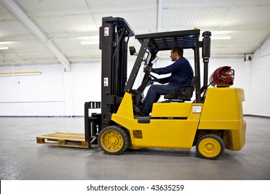 Forklift Truck in empty Warehouse with driver