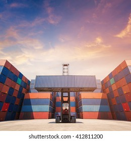 Forklift truck lifting cargo container in shipping yard for transportation import,export, logistic industrial with container stack in background