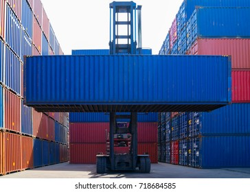 Forklift truck lifting cargo container in shipping yard or dock yard against sunrise sky for transportation import, Export and logistic industrial, Business logistic concept, Import and export concept