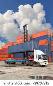 Forklift truck lifting cargo container in shipping yard in background for transportation import,export and logistic industrial concept.