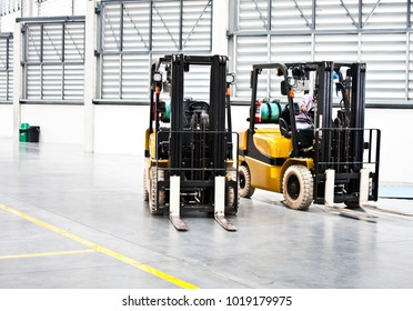 Forklift truck parking in industrial warehouse