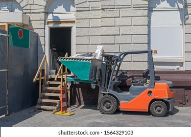 Forklift Truck With Skip Container at Construction Site