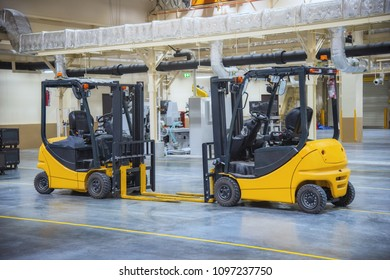 Forklift truck stand by for lifting spare parts in factory.