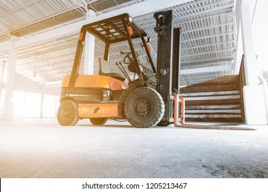 Forklift Truck in Storage Warehouse Ship Yard, Vehicle Factory and Distribution Machine for Products Delivery. Business Industrial Shipping and Logistics Transport. Transportation Machinery