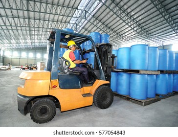 Forklift truck in warehouse
