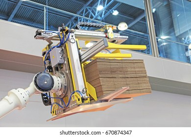 Forklift truck in warehouse robot. The loading of the carton.