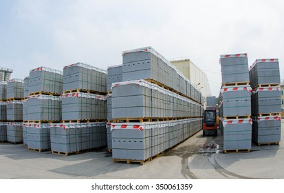 Forklift trucks in stock concrete blocks in outdoor