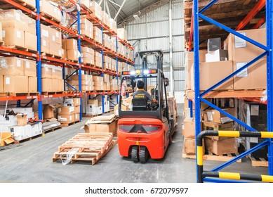 Forklift in Warehouse storage of retail merchandise shop.