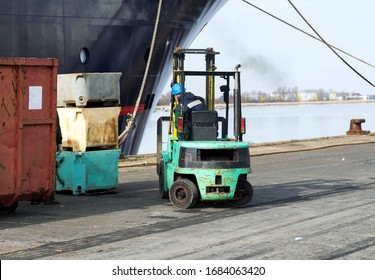 Forklift with worker in the habor, Germany
