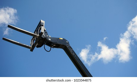 Forklift's head against blue sky