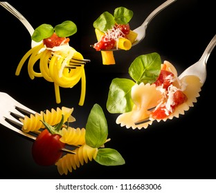 forks with various types of pasta isolated on black background