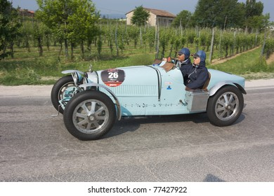"""FORLI', ITALY - MAY 13: Kyoto Takemoto drives a Bugatti Type 35 A (1926) in stage Bologna-Roma of the """"Mille miglia"""" historical race for classic cars, on May 13 2011 in Forli', Italy"""