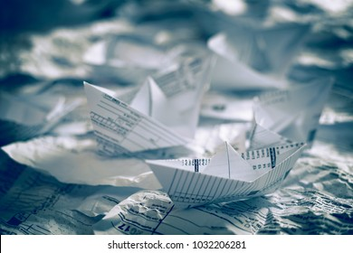 Form 1040 Individual Income Tax return form. United States Tax forms. American blank tax forms. Tax time. Paper boats. 1040, 1041, 1040EZ, 1040-ES, 1065, 1120, 1120S.