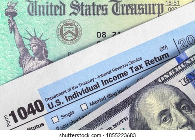 Form 1040 with Tax Refund Check and Money