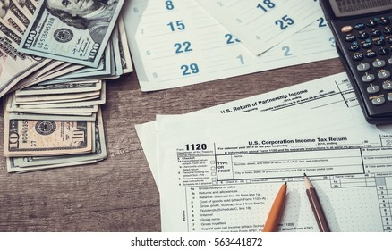 Form 1120 Corporate Tax Return with Calendar, Calculator and Pen. toned image