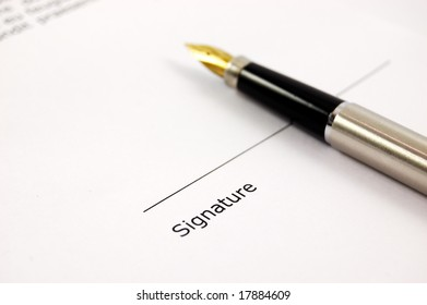 A form of a document with a place for a signature and a gold-nibbed pen