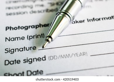 Form for signature with pen. Selective focus image