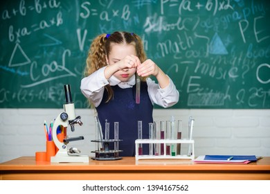 Formal education. Future microbiologist. School laboratory. Girl smart student conduct school experiment. School pupil study chemical liquids. School chemistry lesson. Test tubes with substances.