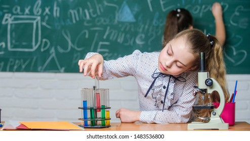 Formal education school. Educational experiment. Back to school. School classes. Girls study chemistry in school. Biology and chemistry lessons. Observe chemical reactions. Theory and practice.