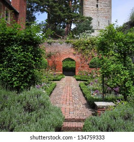 A Formal english Walled garden with path and archway