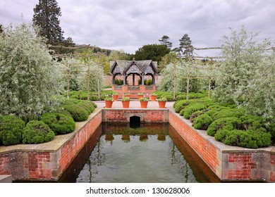 An Formal Landscape garden with water feature and gazebo