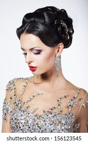 Formal Party. Gorgeous Fashion Model in Ceremonial Shiny Dress with Jewels