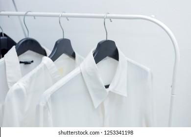 Formal shirts hanging on a hanger