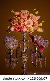 Formal table centerpiece, a beautiful crystal candelabra style candle holder with four hollow-carved designed bowls for candlesticks or tea light candles with a coral flowers vintage bouquet on top