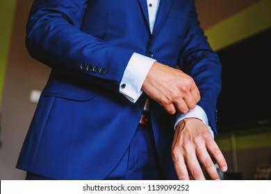 Formal wear.Man dressed in a dark blue jacket, a white formal shirt. Men's fashion. Wedding fashion.