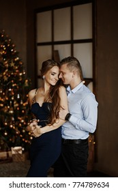 Formally dressed couple is celebrating Christmas together