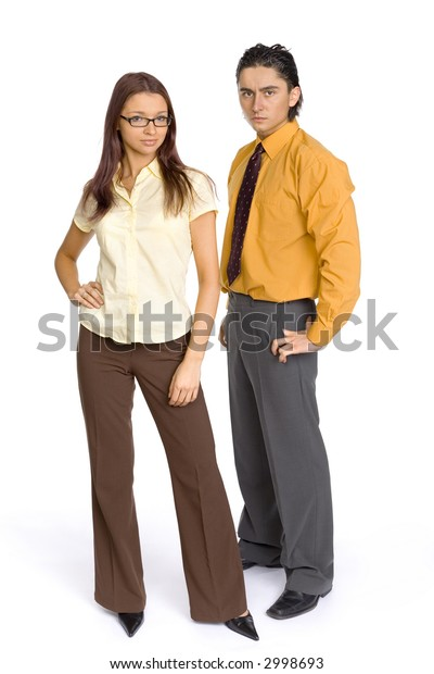 Formalwear man and woman standing on the white background in studio. Both looking at camera. Focus on first person's eyes.