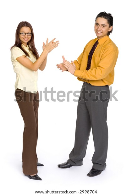Formalwear man and woman standing on the white background in studio. Both looking at camera and clapping.