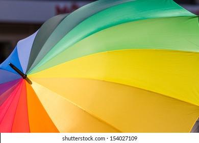 Format filling rainbow-colored umbrella as a symbol for tolerance