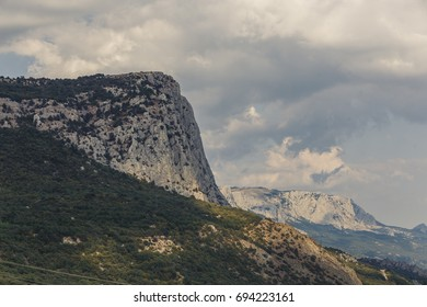 The formation of clouds over the mountain peaks. Crimea.