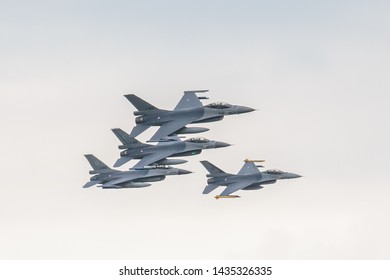 Formation of Dutch fighter jets flying at air show close together. Volkel air base, Netherlands.