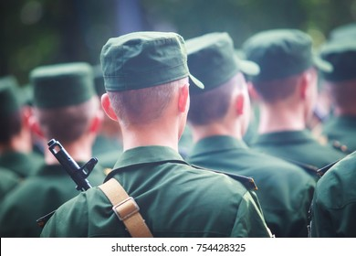 """A formation line of russian army soldiers troops in military formation in uniform with chevron """"Russian Armed Forces"""", line up during the taking the oath of allegiance ceremony"""